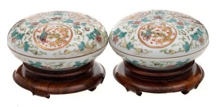A pair of Chinese doucai circular boxes and covers: each decorated with three dragon and phoenix