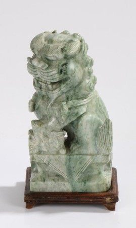 Carved soapstone dog of fo, on a hardwood stand, 23cm high