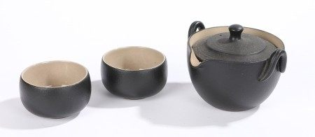 Contemporary Japanese tea set, with a black glazed pot and two bowls each with an impressed seal