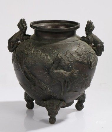 Japanese bronze jardiniere, with dog of fo form handles, the body with raised bird and foliate