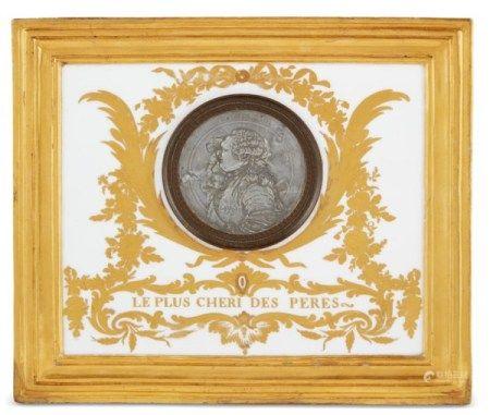 A SEVRES (HARD-PASTE) PORCELAIN PLAQUE INSET WITH A PEWTER PORTRAIT MEDALLION CIRCA 1785, OCHRE CROWNED INTERLACED L'S MARK, GILDER'S HP FOR HENRI-MARTIN PRÈVOST