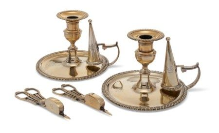 A PAIR OF REGENCY SILVER-GILT CHAMBER CANDLESTICKS AND MATCHING WICK CUTTERS MARK OF THOMAS AND GEORGE HAYTER, LONDON, 1819