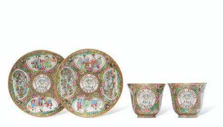 A RARE PAIR OF 'CANTON FAMILLE ROSE' DATED AND INITIALED TEA CUPS AND SAUCERS DATED 1865