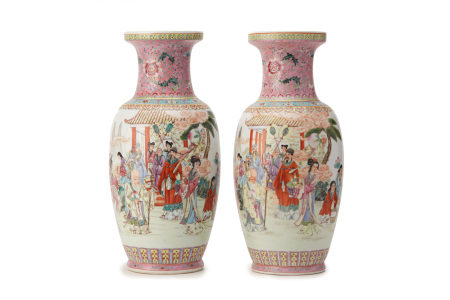 A PAIR OF PINK GROUND FAMILLE ROSE BALUSTER VASES