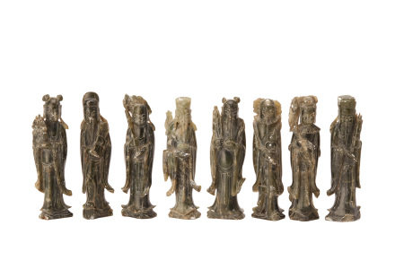 A SET OF EIGHT CHINESE CARVED STONE IMMORTALS