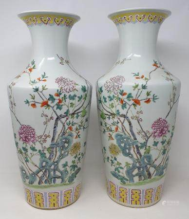 A pair of modern Chinese famille rose vases, decorated flowers, 47 cm high Report by JS This is a