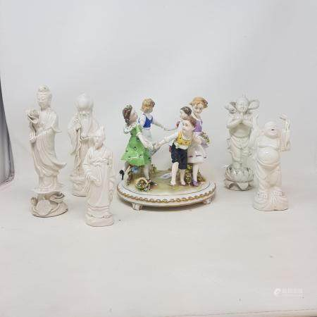 Five Chinese Blanc de Chine figures, and a Capo Di Monte figural group, 20 cm high (6)