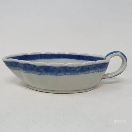 A Chinese blue and white sauceboat, 20 cm wide Chip to rim foot, star crack to base