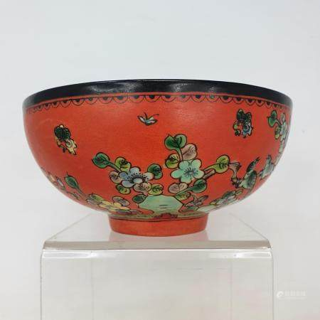 A Chinese red ground bowl, decorated birds, flowers and script, six character mark to base, 14 cm