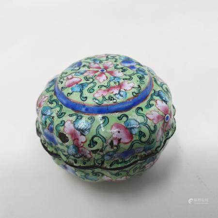 A Canton enamel pot and cover, decorated flowers on a green ground, 3 cm diameter see images