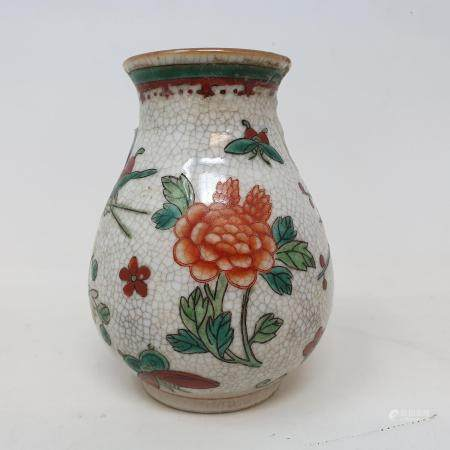 A Chinese polychrome vase, character mark to base, 13 cm high General crazing and rubbing,