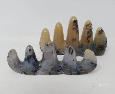 A Chinese hardstone brush stand, in the form of mountains, 11 cm wide, and another similar (2)