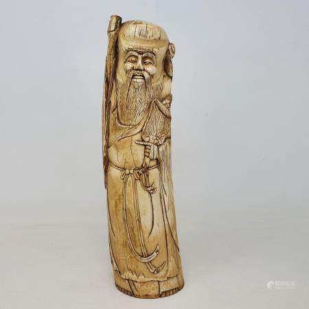 An early 20th century Chinese ivory tusk, carved in the form of Shou Lao, 28 cm high