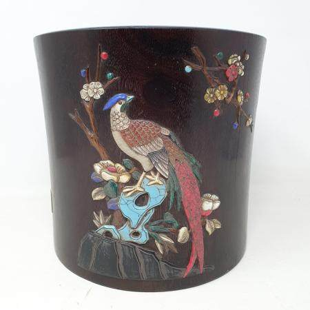 A Chinese wooden brush pot, inset with various coloured stones decorated birds and flowering