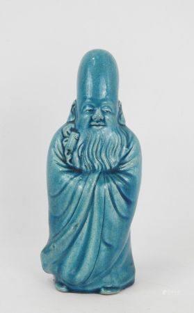 CHINE : Sage en céramique à couverte turquoise. Cachet en creux. Haut.: 24 cm.