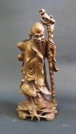 A Chinese Carved Wooden Immortal, 30cm high