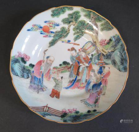 A 19th Century Chinese Famille Rose Saucer decorated with figures in a landscape, six character mark