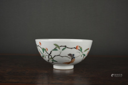 A FAMILLE VERTE 'BUTTERFLY AND FLOWER' BOWL. YONGZHENG PERIOD, QING DYNASTY.