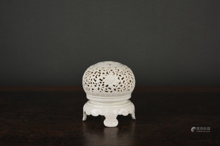 A FINELY CARVED IVORY-GLAZED BURNER. QIANLONG PERIOD, QING DYNASTY.