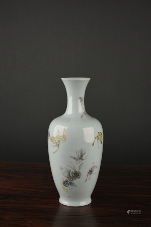 A FAMILLE ROSE 'BUTTERFLY' VASE. QING DYNASTY.