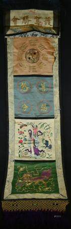 A 19th century Chinese Taoist rectangular silk banner, worked in gilt and coloured threads with a