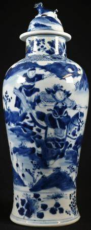 A Chinese baluster vase and cover, painted in underglaze blue with mounted warriors in stylized