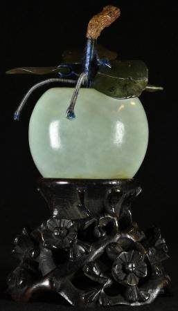 A Chinese hardstone carving, of an apple, 10.5cm high, the hardwood stand pierced and carved with