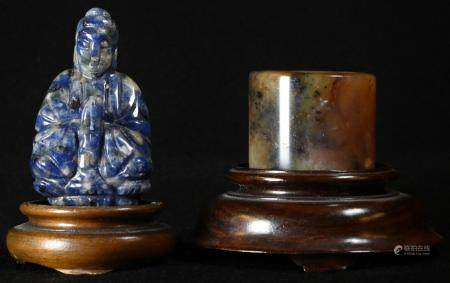 A Chinese lapis lazuli carving, of Buddha, 5.5cm high, hardwood stand; a Chinese russet jade