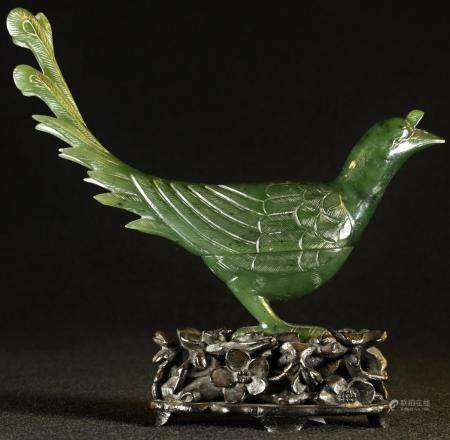 A Chinese spinach jade box and cover, carved as a bird, hardwood stand, 12cm high