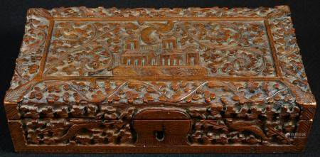 An Indian sandalwood rectangular box, carved with a temple on a ground of scrolling flowering