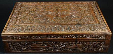 An Indian sandalwood rectangular box, profusely carved with stylised flowers and scrolling leafy