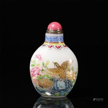 A snuff bottle made of enamel flowers