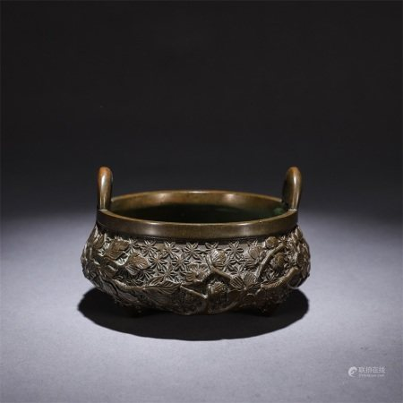 A copper three legged censer with a bunch of lotus