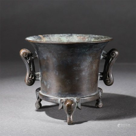 A copper stove with elephant feet