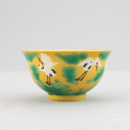 A Chinese yellow, green and aubergine glazed bowl, 20th century.