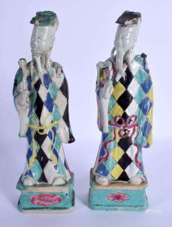 A PAIR OF 18TH CENTURY CHINESE EXPORT HARLEQUIN IMMORTALS Qing, enamelled with motifs. 24.5 cm high.