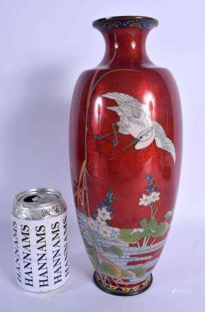 A 19TH CENTURY JAPANESE MEIJI PERIOD CLOISONNE ENAMEL VASE decorated with a bird in flight. 32 cm hi