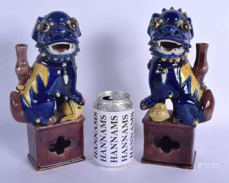 A PAIR OF 19TH CENTURY CHINESE BLUE GLAZED BUDDHISTIC DOGS OF FOE Qing, modelled upon a brown glazed