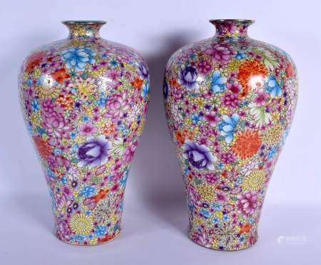 A PAIR OF CHINESE FAMILLE ROSE BALUSTER PORCELAIN VASES 20th Century, painted with flowers. 38 cm hi