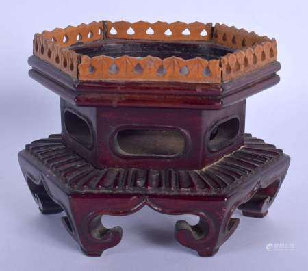 A LATE 19TH CENTURY CHINESE HARDWOOD AND SANDALWOOD STAND Qing, of hexagonal form. 11 cm x 9 cm.