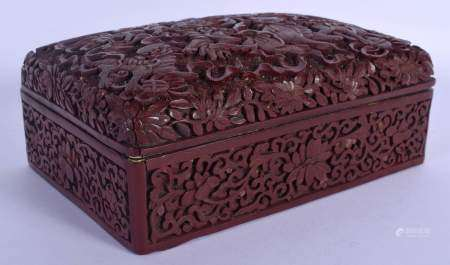 A RARE 19TH CENTURY CHINESE CARVED CINNABAR LACQUER BOX AND COVER Qing, unusually decorated with bud