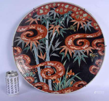A LARGE 19TH CENTURY JAPANESE MEIJI PERIOD KUTANI IMARI CHARGER painted with scrolling coral coloure