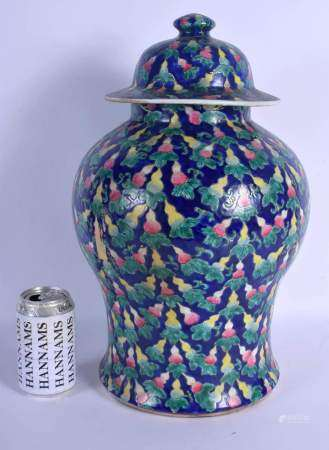 A LARGE CHINESE FAMILLE ROSE BLUE GLAZED BALUSTER JAR AND COVER 20th Century, painted with gourd sha