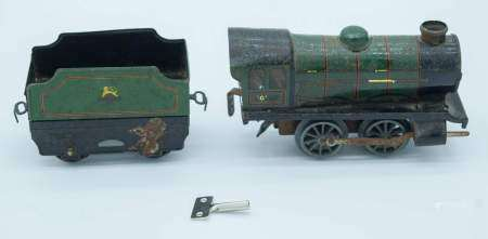 A Hornby wind up Tin plate model train and carriage 13cm . (2)