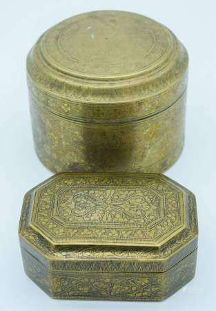 Two Indian 19th century engraved brass boxes largest 9.5cm x 13 cm. (2)
