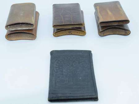 Three vintage leather cigar cases and a Turkish leather wallet. (4)
