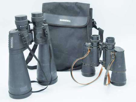 A pair of Bushnell binoculars together with Optomax binoculars . (2)