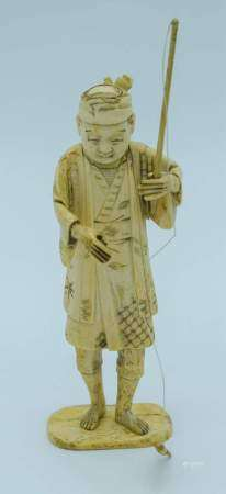 A small Japanese Meiji Period Ivory figure of a fisherman 20cm .