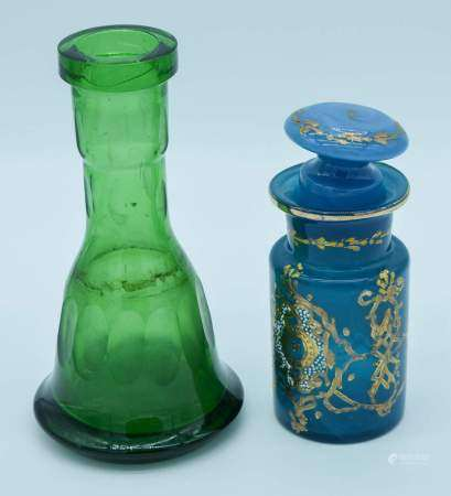 A Middle Eastern glass vase together with a blue vase and a stopper 23cm . (3)