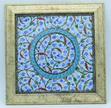 A framed Islamic tile 24 x 24 cm.